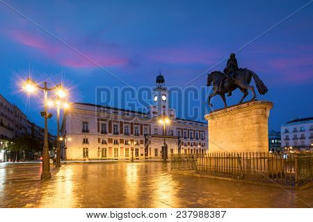 Madrid Cityscape At Night. Landscape Of Puerta Del Sol Square Km 0. Historical Building In Puerta De