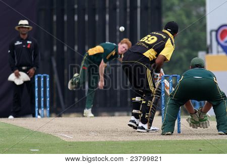 PUCHONG, MALAYSIA - SEPT 24: Malaysia's Hammad U. Khan prepares to bat Guernsey's David Hooper's bowl in this Pepsi ICC WCL Div 6 finals at the Kinrara Oval on September 24, 2011 in Puchong, Malaysia.