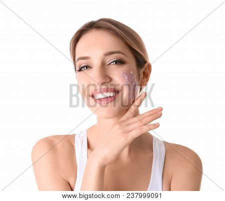 Young Woman Applying Natural Scrub On Her Face Against White Background