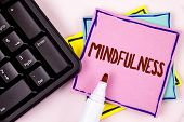 Text sign showing Mindfulness. Conceptual photo Being Conscious Awareness Calm Accept thoughts and feelings written Pink Sticky Note paper plain background Marker and Black Keyboard. poster