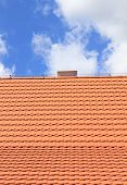 Abstract Red roof background and blue sky poster