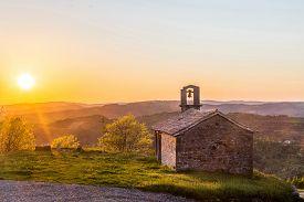 Church St. Rok In Draguc, Istria Croatia In Spring Sundown. Shot Against Evening Sun With Visible Le