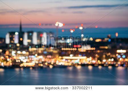 Stockholm, Sweden. Night Skyline Abstract Boke Bokeh Background. Design Backdrop. Klara Church In Ni