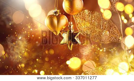 Christmas and New Year golden Decoration. Abstract Blurred Bokeh Holiday Background with beautiful baubles and Blinking Garland. Christmas Tree Lights Twinkling. Xmas backdrop art design