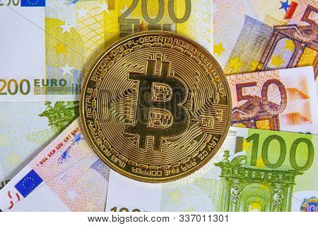 Bitcoin Crypto Currency. Golden Bitcoin On Euro Banknotes Background. Bitcoin Crypto Currency, Block