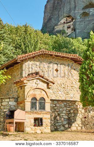 Greek church and monastery in the cliff in Meteora near Kastraki village, Greece