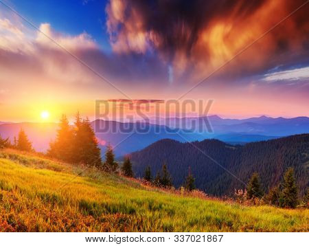 Incredible landscape in the mountains at sunset. Picture of colorful cloudy sky. Location place of Carpathian national park, Ukraine, Europe. Idyllic natural wallpaper. Discover the beauty of earth.