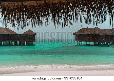 View Of Overwater Bungalow Beach Villas In The Maldives On A Rainy Overcast Day