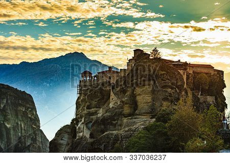 Scenic Sunset Evening Sky Over Holy Varlaam Monastery On Cliff In Meteora, Thessaly Greece. Greek De