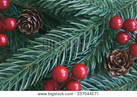 Christmas Decoration Background With Pine Leaves, Pine Cones Or Conifer Cone And Red Holly Balls. Ch