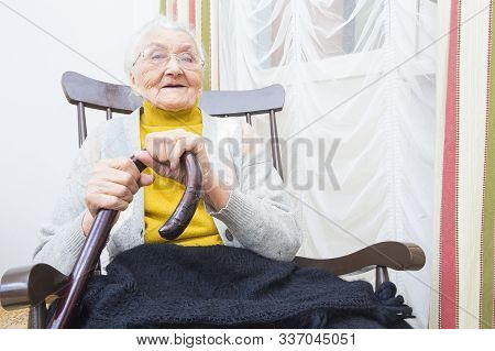Grandmother In A Chair Smiling