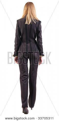 exibição do curta mulher de negócios de volta.  vai menina em terno preto. Coleção de pessoas de vista traseira.