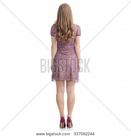 Woman In Dress And High Heels Standing Looking On White Background Isolation, Back View