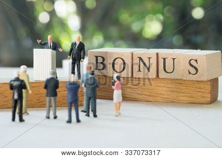 Miniature People: Boss Pay Earnings Profits Of The Business (bonus) To Staff In Annual. Yearly Bonus