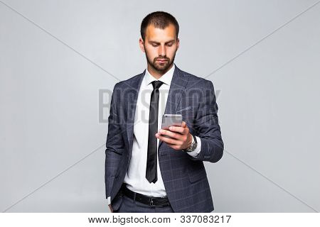 Young Businessman Looking At His Pda Mobile Phone Isolated On White Background