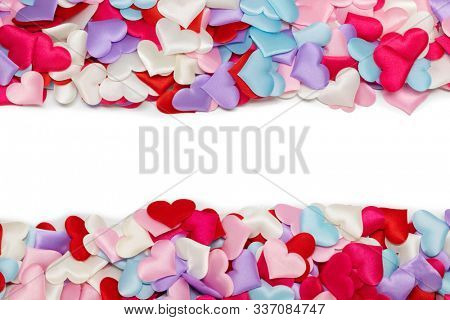 Many satin colorful hearts border frame background. St Valentines Day. Congratulations card on Valentine Day