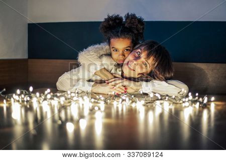 Mother and daughter hugging each other in a festive mood.