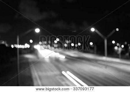 Watching Transport Moving In Street. Urban Traffic. Blurred Car Lights Night. Urban Night. Lights De