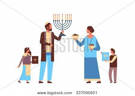 Jews Family Holding Menorah And Gift Boxes Jewish Parents Children In Traditional Clothes Standing T