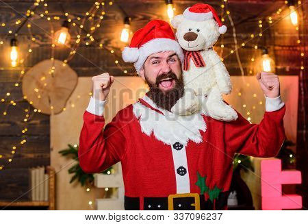 Charity For Kids. Man Bearded Santa Claus Play Soft Toy Teddy Bear. Christmas Charity. Charity Help.