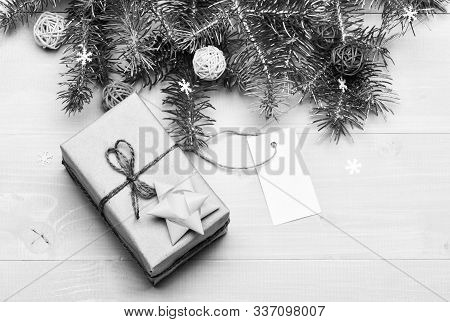 Christmas Decorations Wooden Background Top View. Present Box And Gift Tag Copy Space. Winter Time A