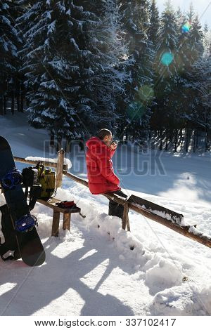 Freerider Rest In Snowy Spruce Forest At Sun Winter Day. Carpathian Mountains At Christmas Holidays,