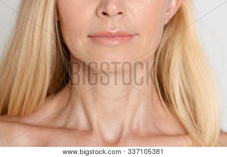 Beautiful Mature Woman With Wrinkled Neck, Grey Background, Crop, Closeup