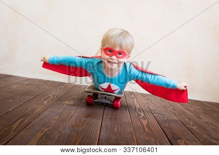 Happy Superhero Child Playing At Home. Super Hero Kid Having Fun. Success, Creative And Start Up Con