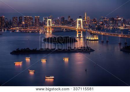 Tokyo skyline with Tokyo Tower and Rainbow Bridge at night in Tokyo, Japan