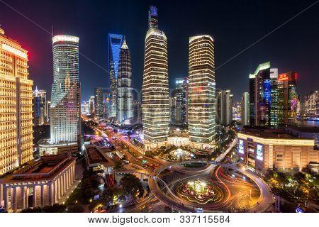 night view of illuminated Lujiazui skyline and Ring Road Circular Footbridge, Shanghai, China