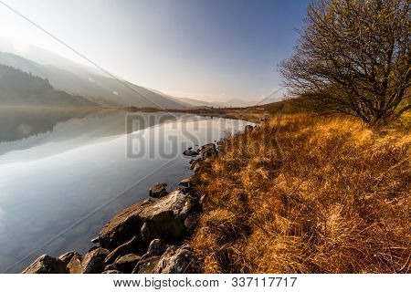 Misty Lake And Mountains On Beautiful Fall Autumn Morning.