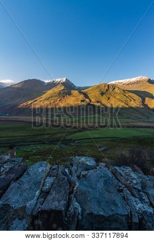 Early Morning Light And Shadow Over Mountains And Snow. Foel Goch And Mynydd Perfedd, Snowdonia.