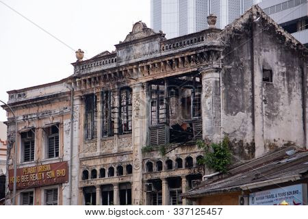 KUALA LUMPUR, MALAYSIA - AUGUST 24,2013: old building and Komtar building - highest building in Penang city. Hystorical view of Penang city and old town(Georgetown), time contrast in arcitecture.