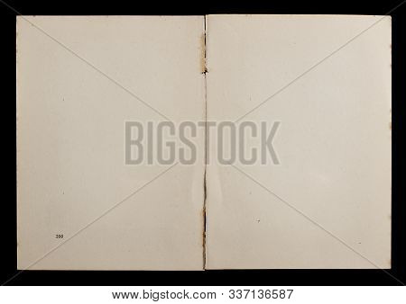 Antique Book Unfolded Showing Textured Pages Isolated On Black Background.