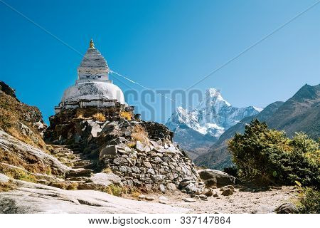 Buddhist Stupa - Architectural And Religious Structure With Ama Dablam 6814m Peak Covered With Snow
