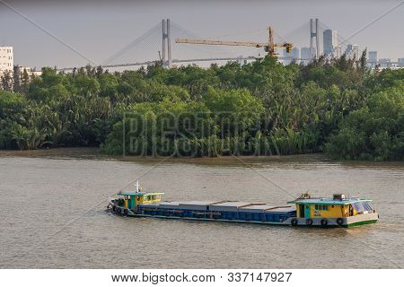 Ho Chi Minh City, Vietnam - March 13, 2019: Sunset Sky Shot Over Song Sai Gon River. Front Steering