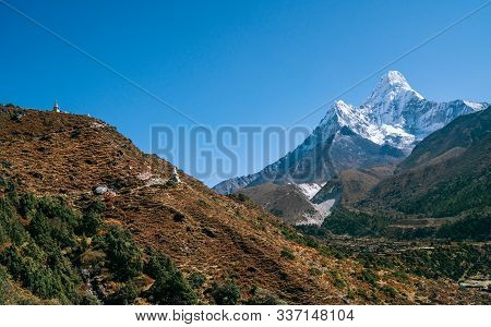 Ama Dablam 6814m Peak Covered With Snow And Ice. Imja Khola Valley In  Sagarmatha National Park. Eve