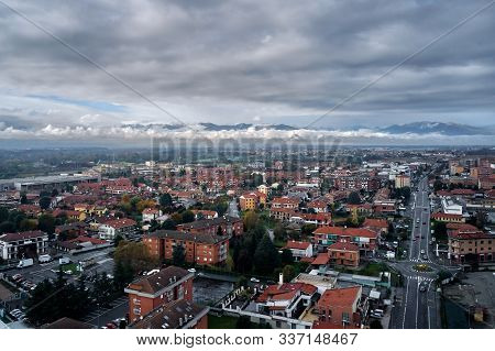 Aerial View Of Italian City Torino Turin In Autumn With The Mountains And Clouds At The Horizon. Pie
