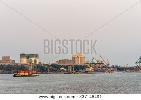 Phuoc Khanh, Vietnam - March 13, 2019: Sunset Sky Shot Over Long Tau River. Industrial Buildings Wit