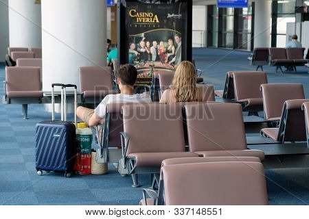 Tbilisi, Georgia - June 9, 2019: Young Tourists Sitting In The Airport Waiting Room. Waiting Chairs
