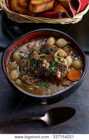 Oxtail Soup With Pearl Onions And Barley Crusty Garlic Bread On The Side