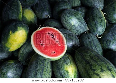 Many Big Sweet Green Watermelons And One Cut Watermelon.young Green Watermelon.watermelon Slice.many