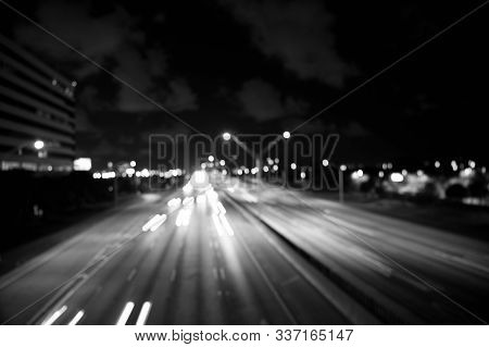 Blurred Night City Lights. Defocused Speed Background. Blur Night Life. Illumination. Abstract Urban