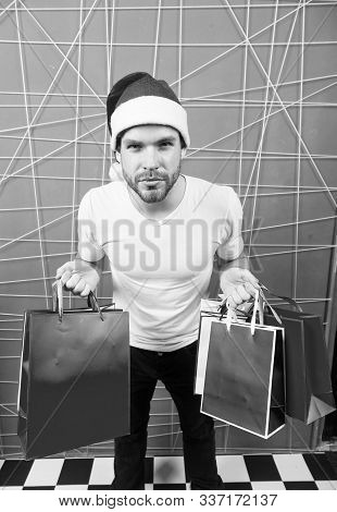 Winter Sale, Shopping Concept. Christmas And New Year Presents. Santa Shopper With Paperbags On Pink