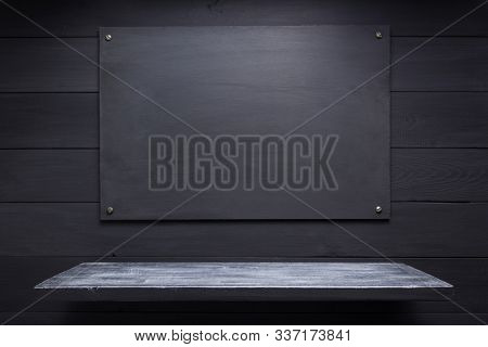 wooden shelf at black background, wall texture surface