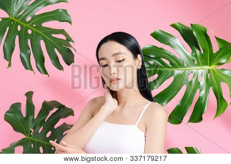 Portrait Of Young And Beautiful Asian Woman Touching Her Face With Perfect Smooth Skin In Tropical L