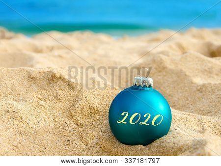 2020 Happy New Year Background, Christmas Ball On The Tropical Beach Near Ocean In Hawaii