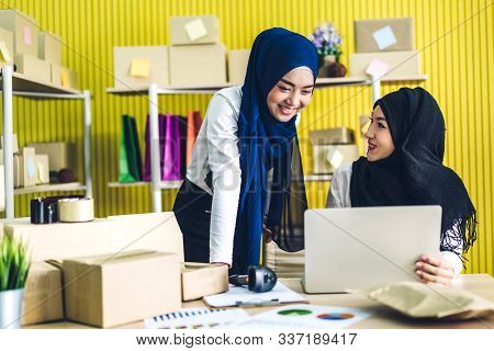Muslim Two Asian Woman Freelancer Sme Business Online Shopping Working On Laptop Computer With Cardb