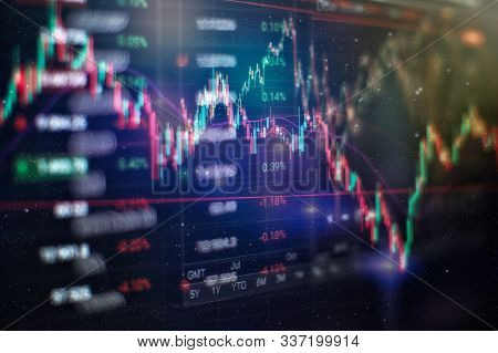 Business And Financial Conceptl Number On Monitor. Background Of Gold And Blue Digital Chart To Repr