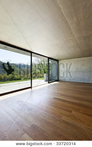 modern concrete house with hardwood floor, detail window